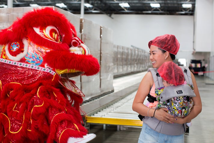 Lion dancer and new friends at Huy Fong Foods