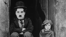 "Charlie Chaplin and Jackie Coogan, publicity photo from ""The Kid"""