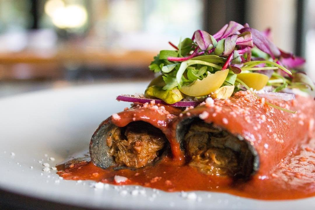 Duck confit enchiladas at Broken Spanish
